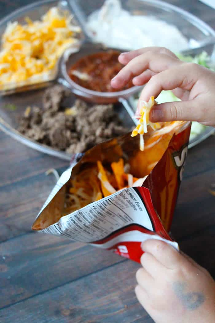 This is by far the dinner my kids request the most due to the fun factor - Doritos Taco Salad Recipe in a Bag! Doritos, taco meat, & cheese = perfection. happymoneysaver.com