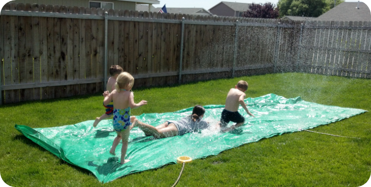 giant slipping slide fun - 20 summer activities on a budget