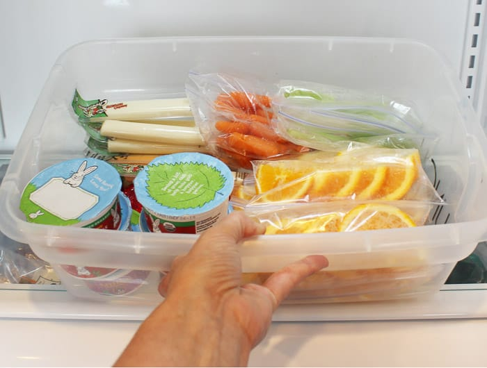 Make school lunches easy by adding your food to a bucket in the fridge! Perfection!