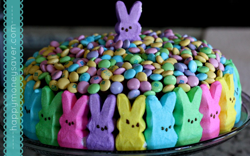 This Peeps Easter Cake is possibly the cutest Easter cake I have ever seen! Make a chocolate cake, cover the sides with peeps, and top with Easter m+m's!!!| Happymoneysaver.com