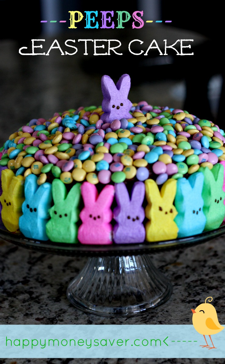 This Peeps Easter Cake is possibly the cutest Easter cake I have ever seen! Make a chocolate cake, cover the sides with peeps, and top with Easter m+m's!!! | Happymoneysaver.com