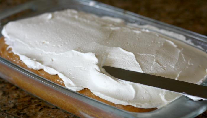 Coconut Cream Poke Cake - uses cream of coconut and sweetened condensed milk to make it so moist. My new favorite cake!!!