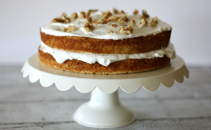 This vintage banana cake recipe is to die for. Cake is moist and has a sweet banana flavor. It is frosted with homemade whipped cream and chopped walnuts.