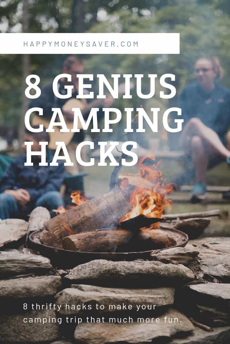 8 Genius Camping Hacks words with family sitting around campfire image
