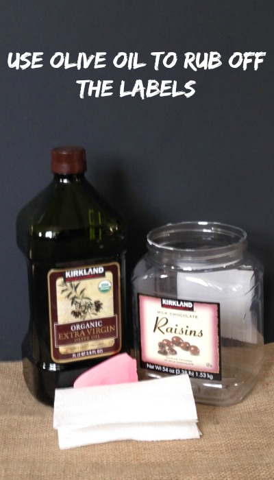 Use olive oil to rub off the labels off of old containers!  So easy!