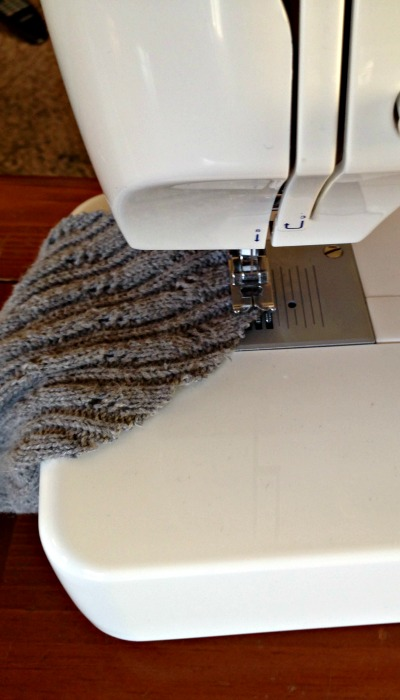 Hem an old sweater to make boot socks