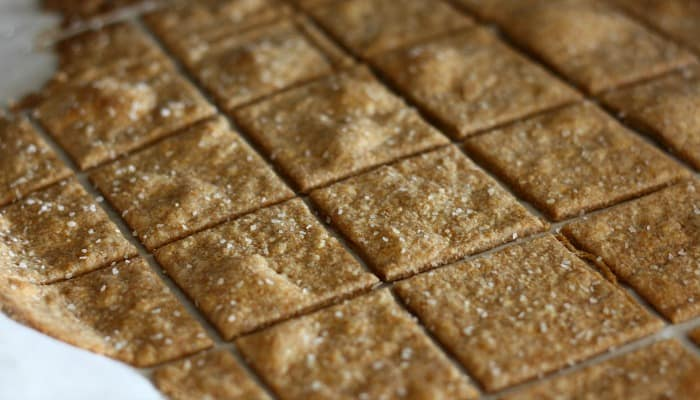 Make your own crackers! These Homemade Wheat Thin Crackers take about 10 minutes to make, taste better than store bought and are made with real ingredients that you can actually pronounce.