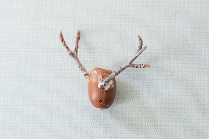 Its so simple! Just glue your twigs onto the acorn to create your fauxidermy deer head napkin ring.