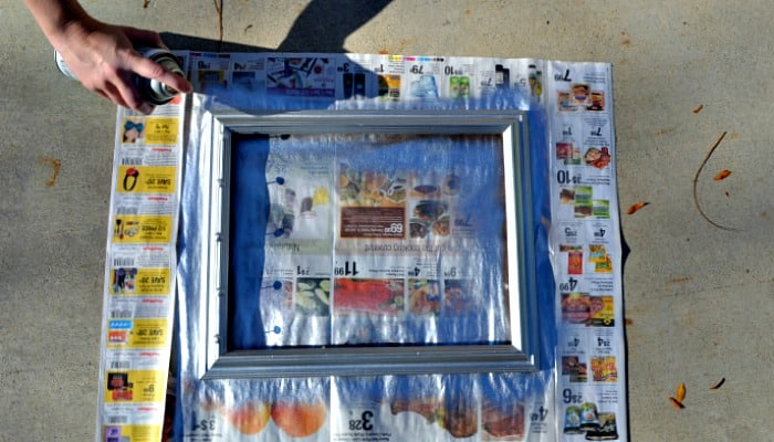 Paint an old frame to make a bow organizer