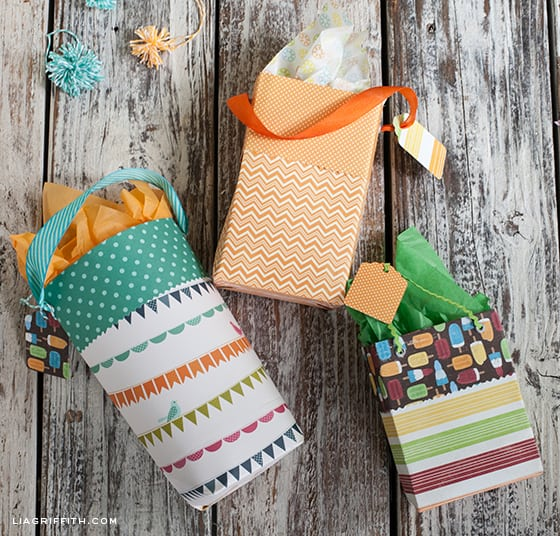 I've never considered making gift bags from scrapbook paper, but this looks so awesome!