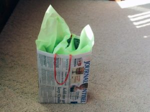 This might be the most frugal way to make a gift bag because almost everyone has newspaper around the house!