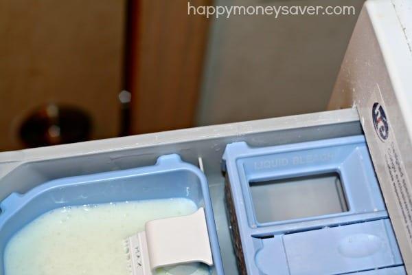 Adding homemade liquid laundry detergent to your washer. happymoneysaver.com