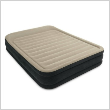 A queen inflatable bed with light brown  on top.