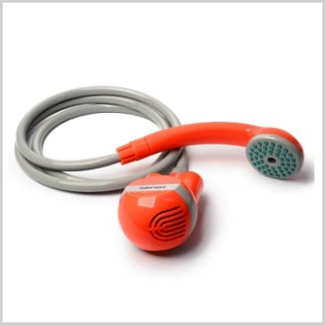 A handheld portable shower in red and grey in a list of cool camping equipment.