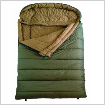 A green sleeping bag zipped open at the top and folded down.