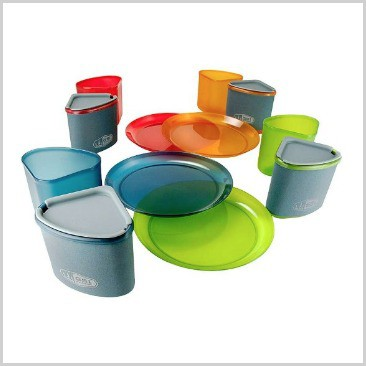 Plates and cups in colored plastic on a list of 18 cool camping equipment ideas.