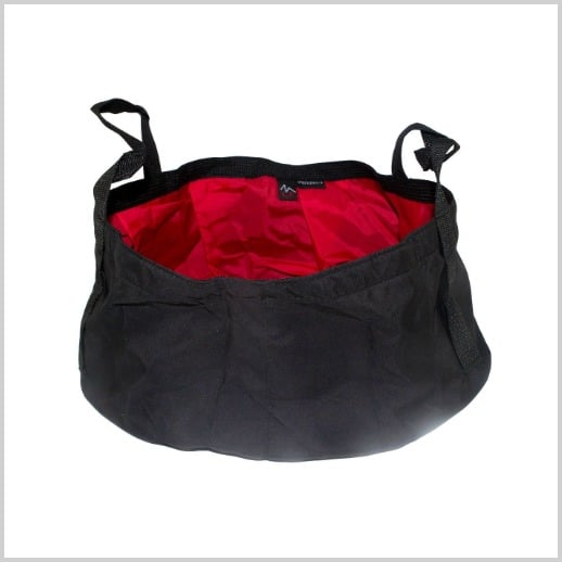 A portable folding washing basin in black with a red lining.