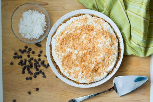 The smooth coconut custard and sweet chocolate ganache are sure to make all of your Chocolate Coconut Pie dreams come true! Straight forward and easy recipe. | happymoneysaver.com