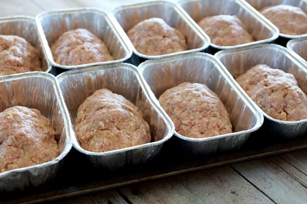 You are going to love this Freezer Mini Meatloaf Recipe! Stock up the freezer for those busy nights...so delicious and a sinch to make, what's not to love? | happymoneysaver.com