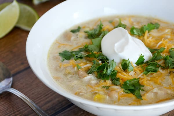 This creamy white chicken chili recipe is so delicious and full of flavor! Easily double or triple the batch and stock up your freezer! | happymoneysaver.com