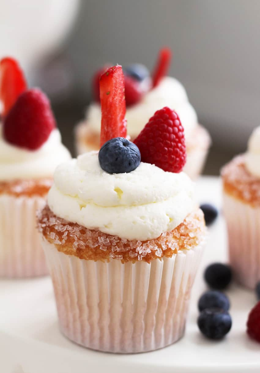 Berries on a Cloud Cupcake Recipe. The BEST cupcake recipe you will ever have in your life. The secret? Dipping the cupcakes in sugar crystals for the perfect crunch with the mascarpone frosting being ever so light and perfect.