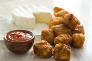 Fried Brie Bites - Crunchy, creamy and oh so cheesy. You can also make ahead and freeze them for last minute company or for a party. YUMMERS!!!