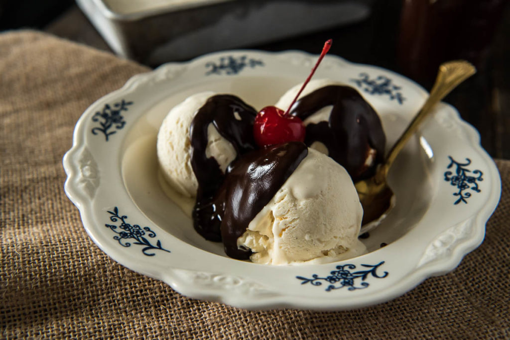 This No-Churn Homemade Vanilla Ice Cream recipe is SO easy - no extra appliances required! (Top it with Freezer Friendly Hot Fudge Sauce for a real treat!) | happymoneysaver.com