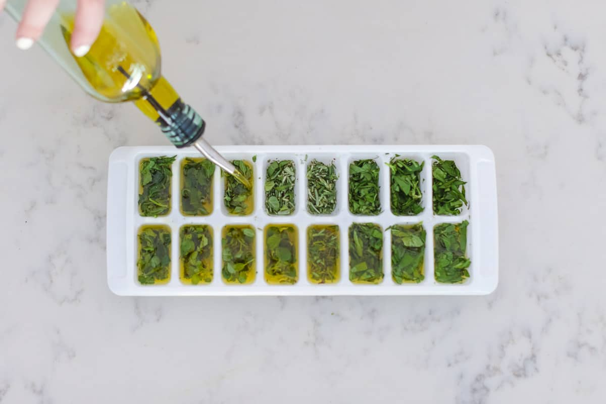 Have fresh herbs all year round with this simple Preserving Herbs with Olive Oil hack.