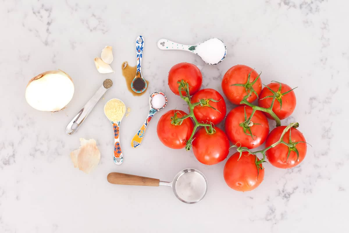 measuring tools, ingredients and fresh tomatoes