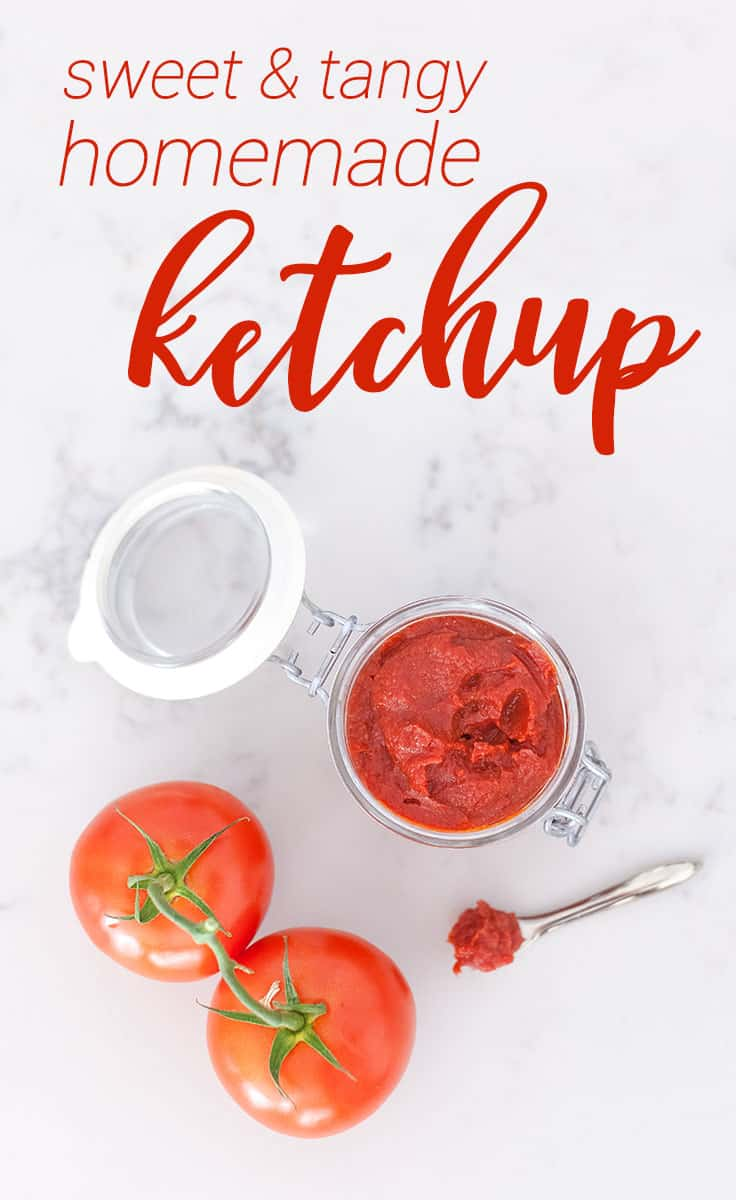 fresh garden tomatoes with homemade ketchup in a jar