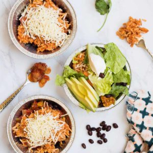 Nothing beats a good Chicken Burrito Bowl! It is packed with seasoned chicken, homemade Spanish Rice, beans, cheese, salsa, and all the fresh toppings your heart desires. Yum!