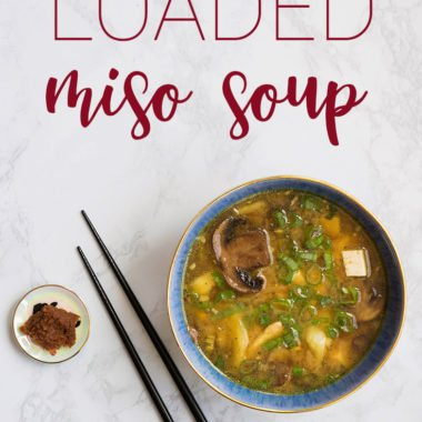 Miso soup recipe in a blue bowl with chopsticks and miso paste