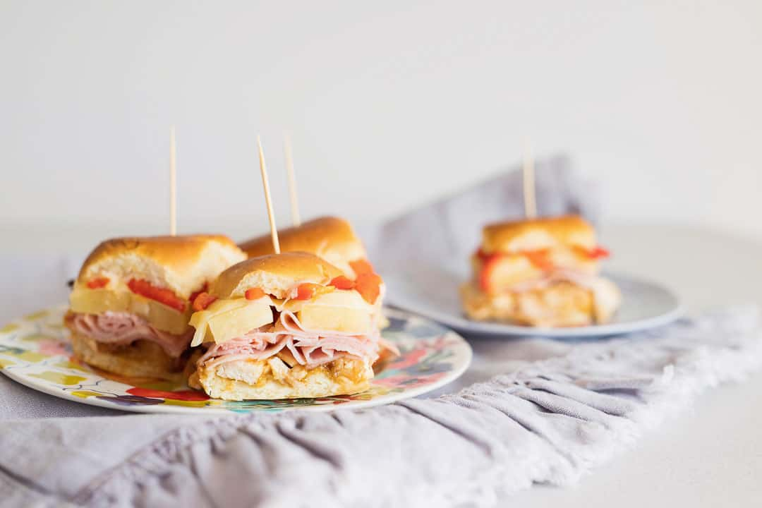 This make ahead ham and cheese sliders recipe without poppyseed is one of the best freezer meals for summer! Just pull out of freezer & bake! #easyrecipe #sliders #appetizer #hamandcheese #hawaiianrolls #makeahead #summer