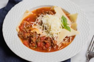 Everything you love in a lasagna, except in a stew! This Lasagna Stew is full of meat, tomatoes, herbs, pasta, and cheese. YUM!