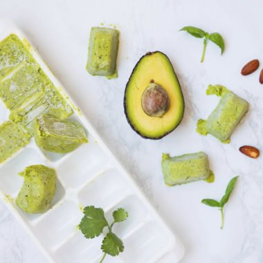 ice cube tray with avocado pesto in it