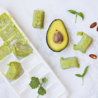 ice cube tray with avocado pesto in it
