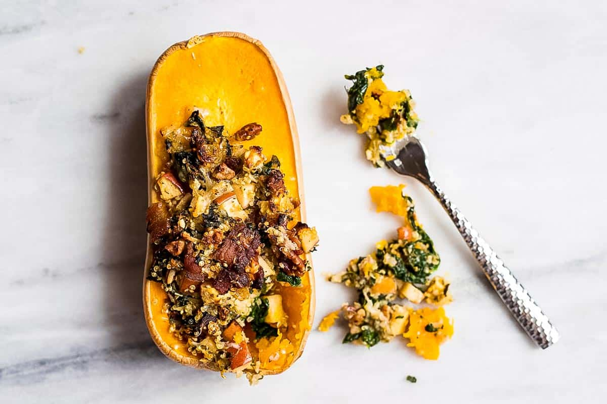 Stuffed Butternut Squash recipe filled with bacon, pecans, quinoa, apples, and spinach. So good.