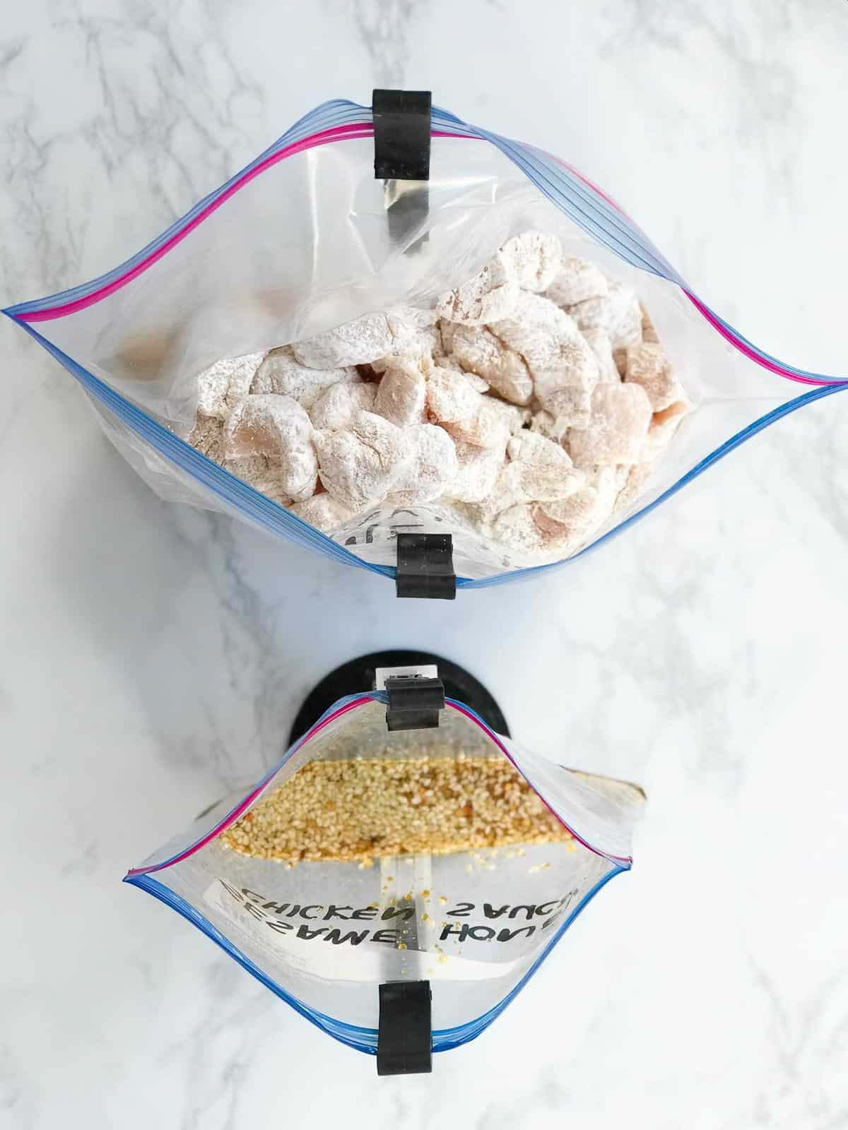 Cut up chicken pieces dusted with flour added to a resealable bag held in bag holders and a smaller bag of seasonings also held with bag holders.