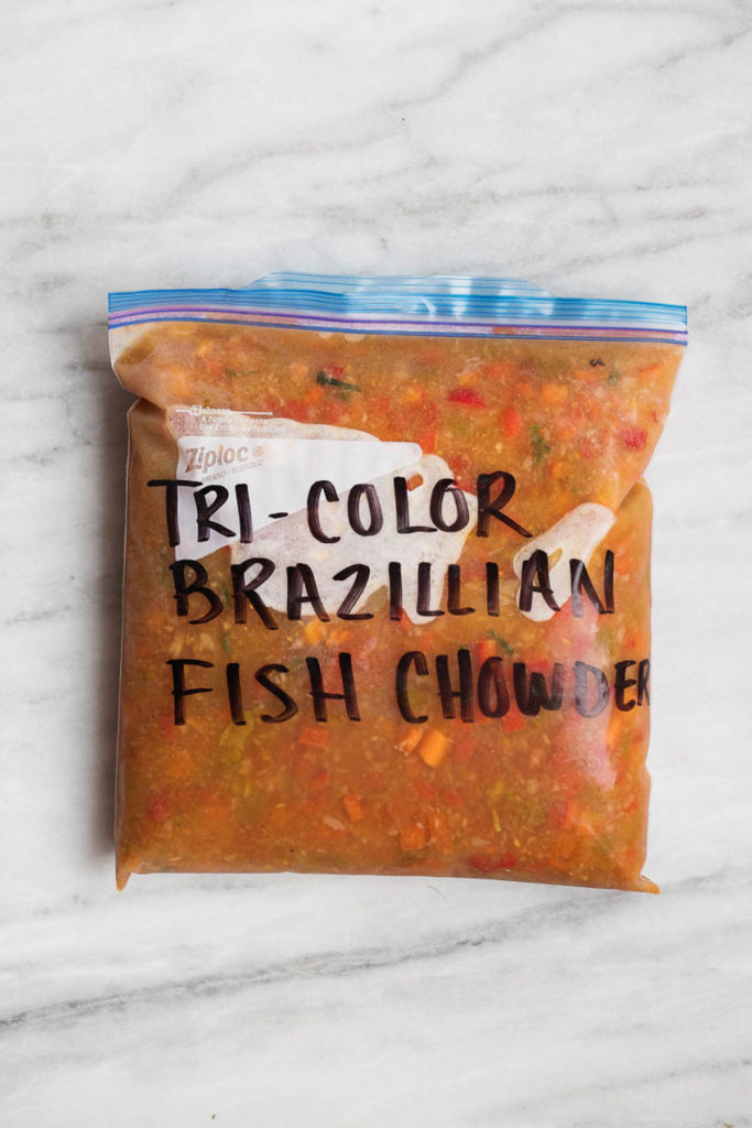 Tri color Brazilian fish chowder in a gallon sized freezer safe bag. Moqueca