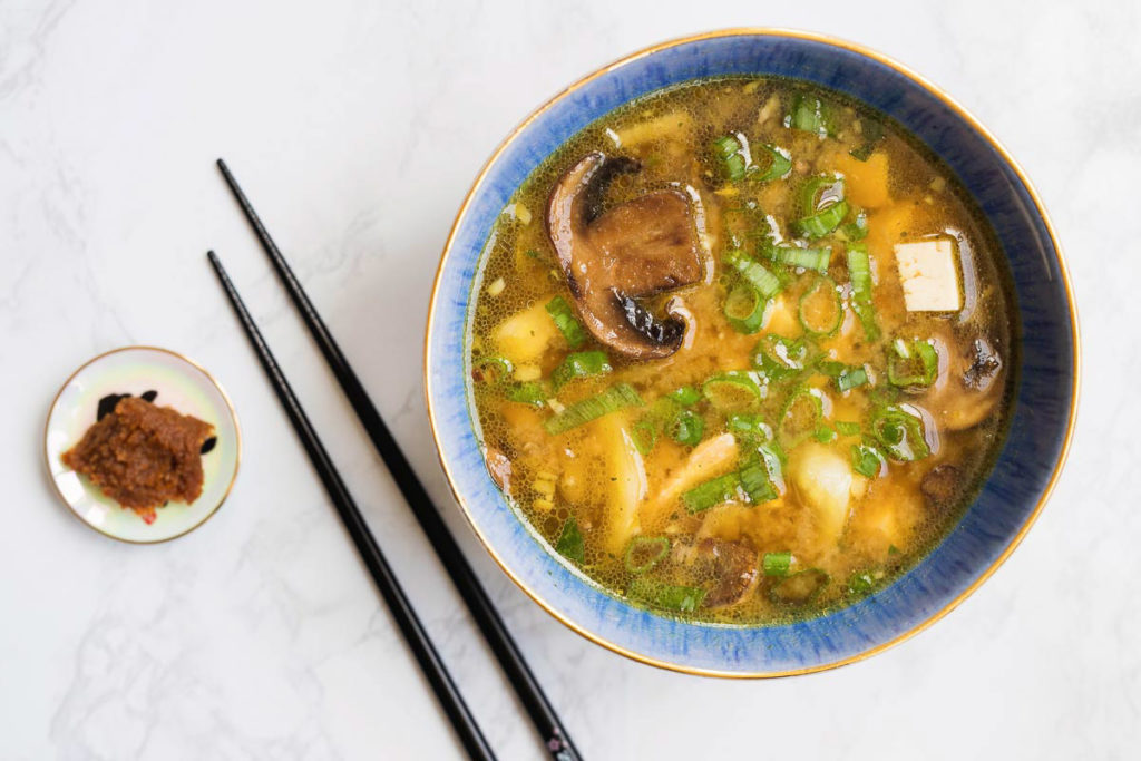miso soup recipe in a blue bowl with chopsticks