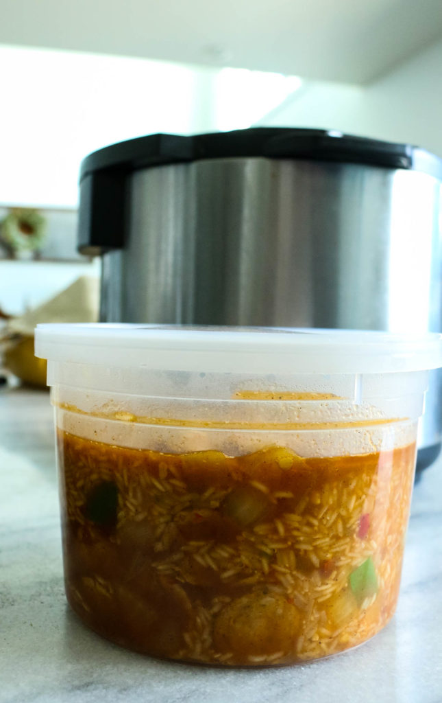 Instant Pot Container filled with Cajun Chicken sausage and rice freezer meal recipe.