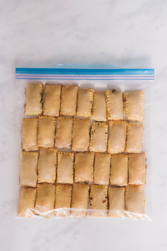 A zippered bag with 28 mini homemade pop tarts in it.