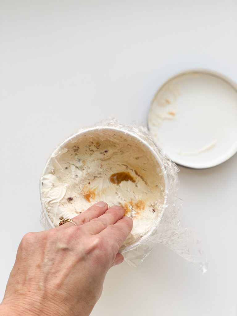 Best way to prevent freezer burn on ice cream is to add plastic wrap on top of any unused portions and add lid back on.