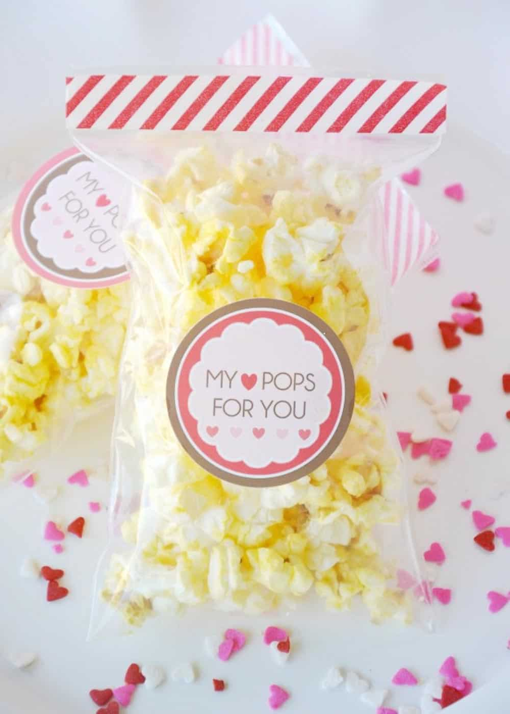 Hy Heart pops for you Valentine Idea with a bag full of popcorn and cute tags.