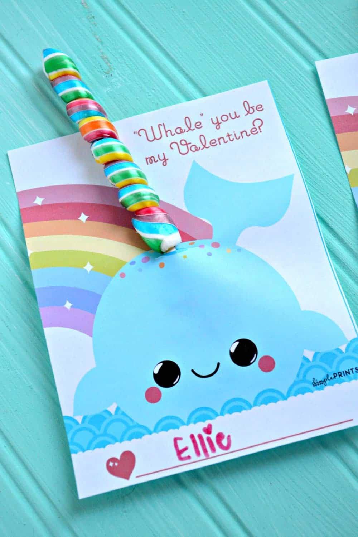 Cute Narwal Valentine card with rainbow sucker candy. DIY Valentines for Kids