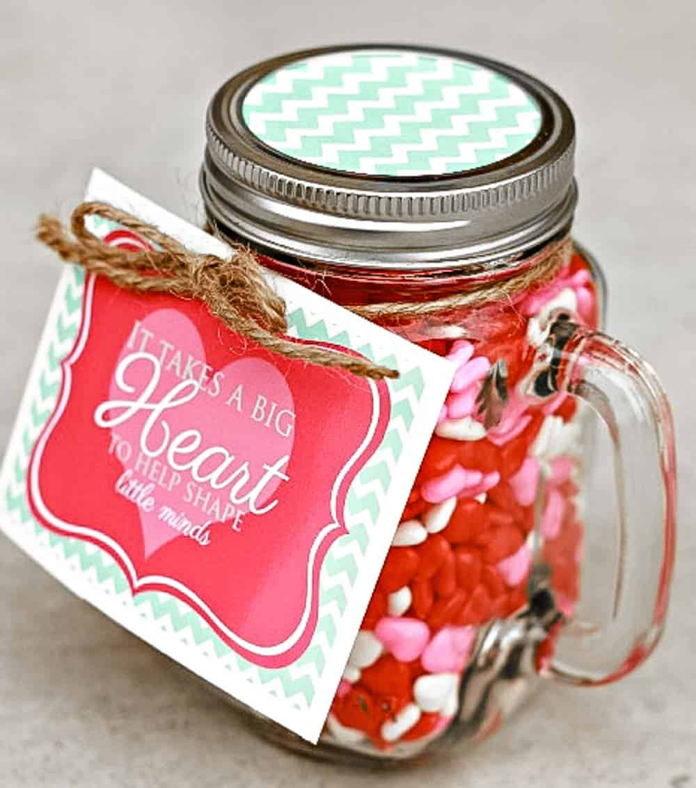 Jar of Candy hearts with Tag that reads It Takes a Big Heart to help Shape Little Minds.