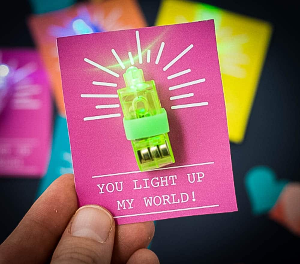 DIY Valentine for Kids using a neaon green finger light with hot pink tag saying you light up my world.