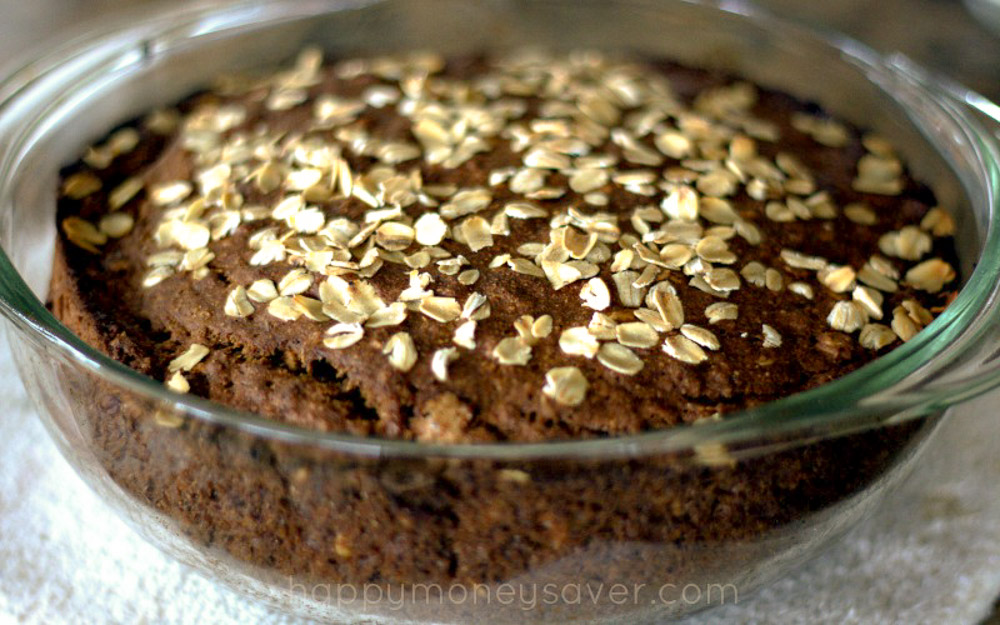 Best ever Irish Brown Bread recipe - in a glass bowl with oats on top of bread.