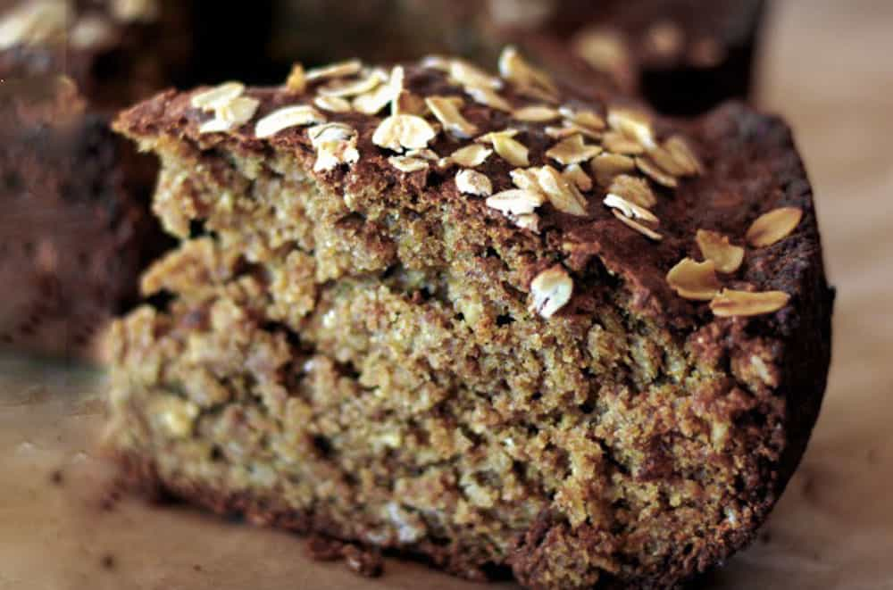 Moist guinness brown bread slice with oats. Dark brown in color.