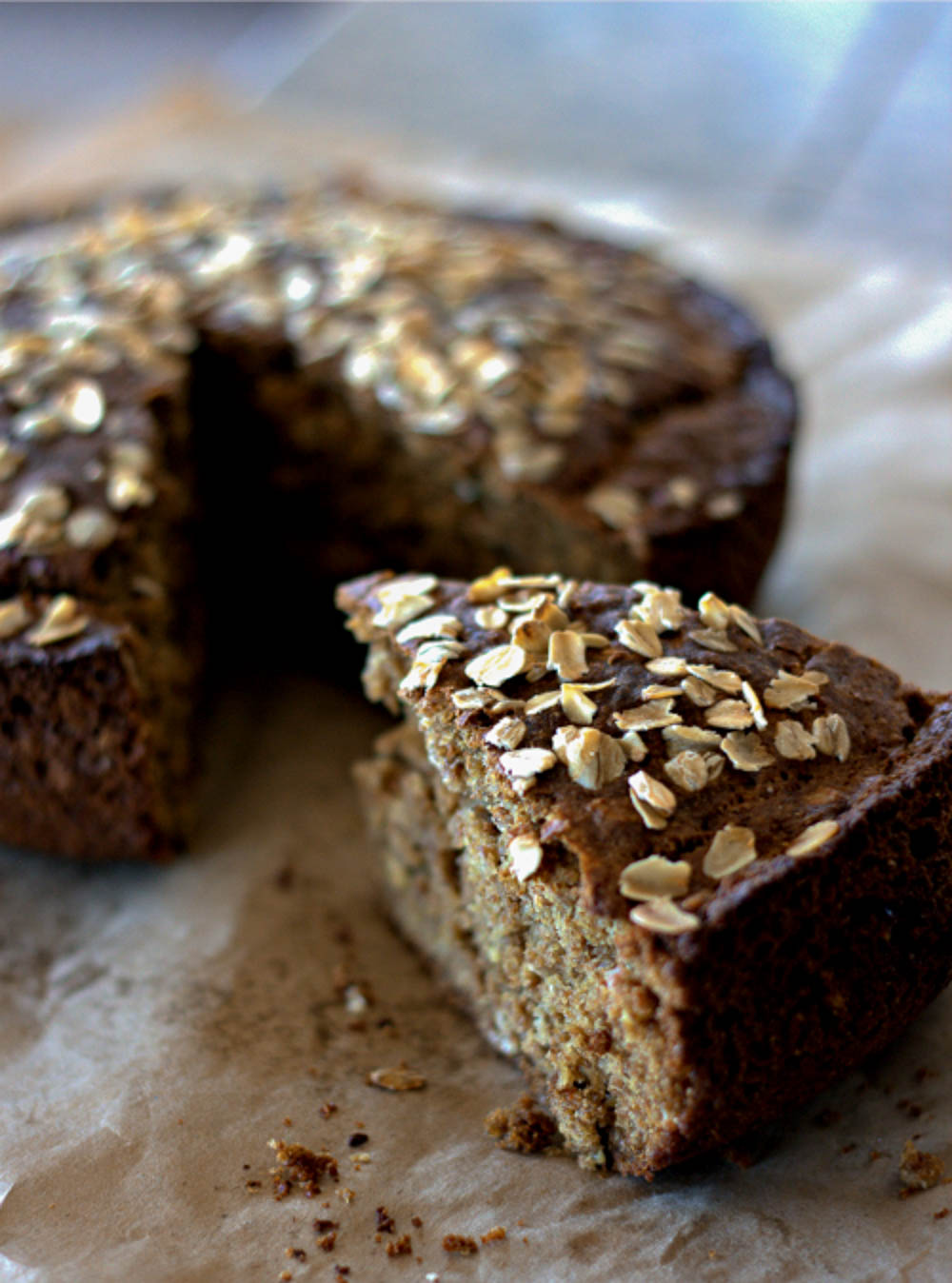 Dark brown Irish Brown soda bread with oats on top.